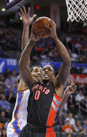 Toronto Raptors guard DeMar DeRozan (10) goes up for a shot in front of Oklahoma City Thunder guard Thabo Sefolosha (2) during the first quarter of an NBA basketball game in Oklahoma City, Tuesday, Nov. 6, 2012. (AP Photo/Alonzo Adams)