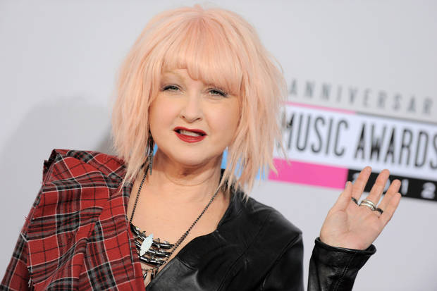 Cyndi Lauper arrives at the 40th Anniversary American Music Awards on Sunday Nov. 18, 2012, in Los Angeles. (Photo by Jordan Strauss/Invision/AP)
