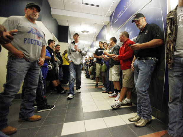 Fans line a hall of the Case Athletic Building while seeking shelter from a severe thunderstorm before the Oklahoma State-Tulsa game on Saturday. Photo by Nate Billings, The Oklahoman