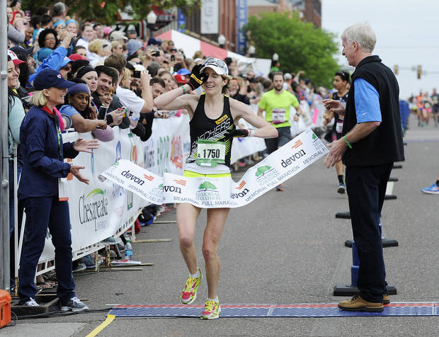 Women's marathon winner Camille Herron crosses the finish line of the 15th annual Oklahoma City Memorial Marathon in Oklahoma City on Sunday, April 26, 2015. Herron finished the race in 2:09:47 and it is her third memorial marathon victory. Photo by KT King, For The Oklahoman