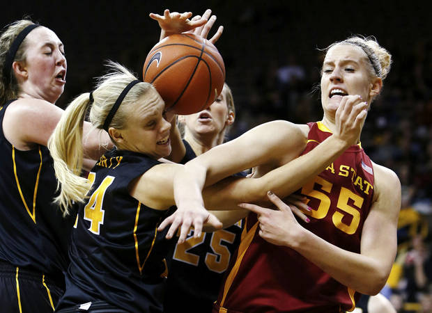 Iowa State center Anna Prins (55) draws a foul on Iowa guard Jaime Printy (24) as they battle for a rebound during the first half an NCAA college basketball game Thursday, Dec. 6, 2012 at Carver-Hawkeye Arena in Iowa City, Iowa.  (AP Photo/The Gazette,Brian Ray)
