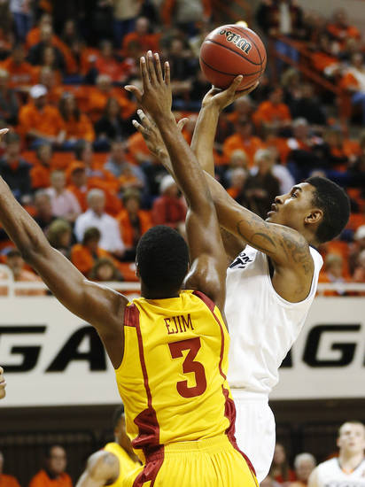 Oklahoma State guard Le&#039;Bryan Nash, right, shoots in front of Iowa State forward Melvin Ejim during the first half of an NCAA college basketball game in Stillwater, Okla., Wednesday, Jan. 30, 2013. (AP Photo/Sue Ogrocki)
