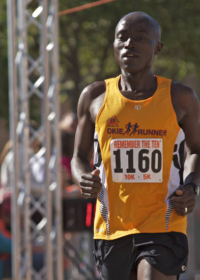 Daniel Mutai runs pass the finishing line, finishing first in the 5K section of the Remember the Ten run held in Stillwater, Okla., on April 21, 2012. Photos by Mitchell Alcala for the Oklahoman  ORG XMIT: KOD