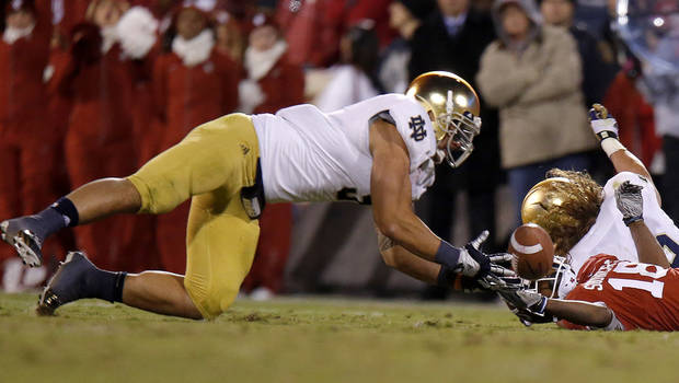 Notre Dame's Manti Te'o (5) intercepts a pass intended for OU's Jalen Saunders (18) during the college football game between the University of Oklahoma Sooners (OU) and the Notre Dame Fighting Irish at Gaylord Family-Oklahoma Memorial Stadium in Norman, Okla., Saturday, Oct. 27, 2012. Oklahoma lost 30-13. Photo by Bryan Terry, The Oklahoman
