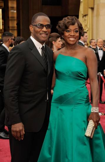 Julius Tennon, left, and Viola Davis arrive at the Oscars on Sunday, March 2, 2014, at the Dolby Theatre in Los Angeles. (AP)