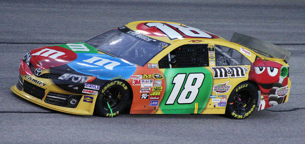 Sprint Cup Series driver Kyle Busch (18) drives through Turn 4 late in the NASCAR Sprint Cup Series auto race at Atlanta Motor Speedway in Hampton, Ga., Sunday, Sept. 1, 2013. Busch won the race to secure a spot in the Chase. (AP Photo/Dale Davis)