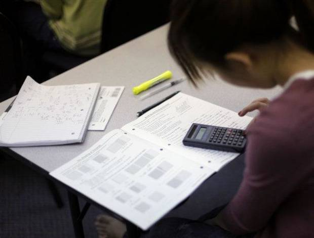Students learn about decimals and fractions during an Oklahoma City GED class at the Adult Learning Center on Thursday night. The loss of state funding will mean fewer classes, instructors and students across the state. Photo by Garett Fisbeck, The Oklahoman <strong>Garett Fisbeck - Garett Fisbeck</strong>