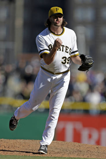 Pittsburgh Pirates closer Jason Grilli (39) celebrates getting the third out of the ninth inning to preserve a 4-2 Pirates win over the Atlanta Braves in a baseball game in Pittsburgh Sunday, April 21, 2013. (AP Photo/Gene J. Puskar)