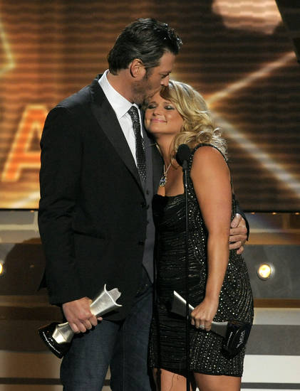 "Miranda Lambert, right, and Blake Shelton accept the award for song of the year for ""Over You"" at the 48th Annual Academy of Country Music Awards at the MGM Grand Garden Arena in Las Vegas on Sunday, April 7, 2013. (Photo by Chris Pizzello/Invision/AP) ORG XMIT: NVPM262"