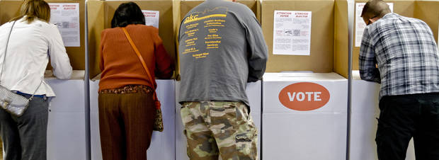 Voters fill out their ballot during election day on Tuesday, Nov. 6, 2012, in Yukon, Oklahoma. Photo by Chris Landsberger, The Oklahoman
