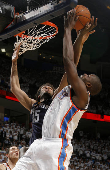 Oklahoma City's Nazr Mohammed (8) shoots over Hamed Haddadi (15) of Memphis during game five of the Western Conference semifinals between the Memphis Grizzlies and the Oklahoma City Thunder in the NBA basketball playoffs at Oklahoma City Arena in Oklahoma City, Wednesday, May 11, 2011. Photo by Sarah Phipps, The Oklahoman