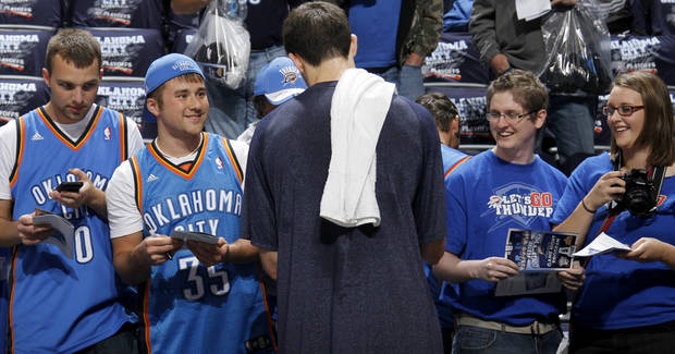 Fans get the autograph of Oklahoma City's Nick Collison before the NBA basketball game between the Denver Nuggets and the Oklahoma City Thunder in the first round of the NBA playoffs at the Oklahoma City Arena, Wednesday, April 27, 2011. Photo by Bryan Terry, The Oklahoman