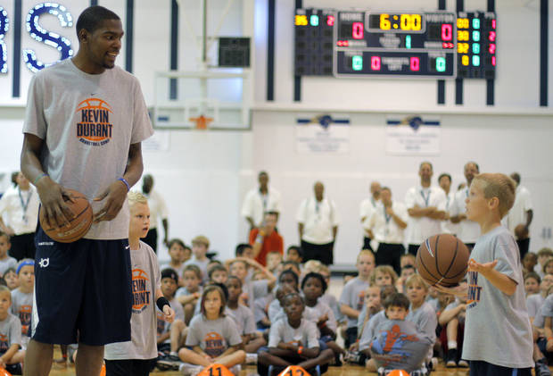 Kevin Durant goes head-to-head in a shootout with Jake Cochnauer, 8 of Minnesota, during the second day of the Kevin Durant basketball camp at Heritage Hall in Oklahoma City, Thursday, June 30, 2011.  (AP Photo/The Oklahoman, Garett Fisbeck)