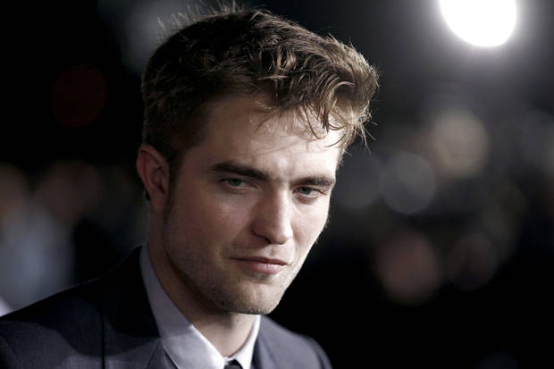"Robert Pattinson arrives at the world premiere of ""The Twilight Saga: Breaking Dawn - Part 1"" on Monday, Nov. 14, 2011, in Los Angeles. (AP Photo/Matt Sayles) ORG XMIT: CASH189"