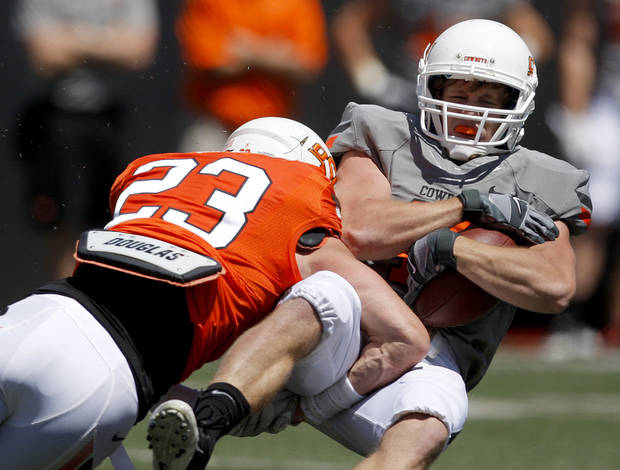 OSU's  Brent Anderson is brought down by Zack Craig during Oklahoma State's spring football game at Boone Pickens Stadium in Stillwater, Okla., Saturday, April 21, 2012. Photo by Bryan Terry, The Oklahoman