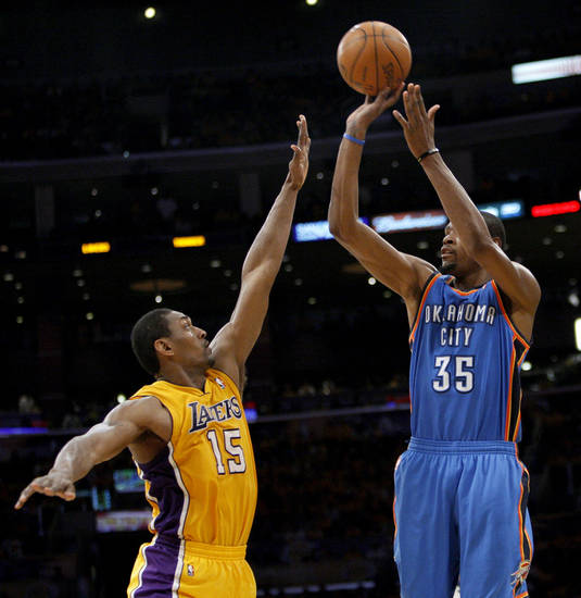 Oklahoma City&#039;s Kevin Durant (35) shoots over Los Angeles&#039; Metta World Peace (15) during Game 3 in the second round of the NBA basketball playoffs between the L.A. Lakers and the Oklahoma City Thunder at the Staples Center in Los Angeles, Friday, May 18, 2012. Photo by Nate Billings, The Oklahoman