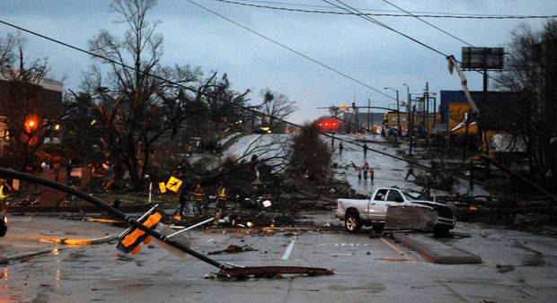 Hardy Street in front of the University of Southern Mississippi campus is obstructed by debris blown by an apparent tornado in Hattiesburg, Miss., Sunday, Feb. 10, 2013. (AP Photo/The Student Printz, Jana Edwards) ORG XMIT: MSHAT102