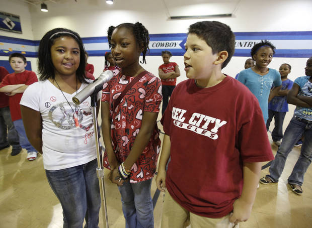 Fifth-grade students Alycia Rosario, left, Semya Phanor and Micah Mayden sing a presidential election rap song.