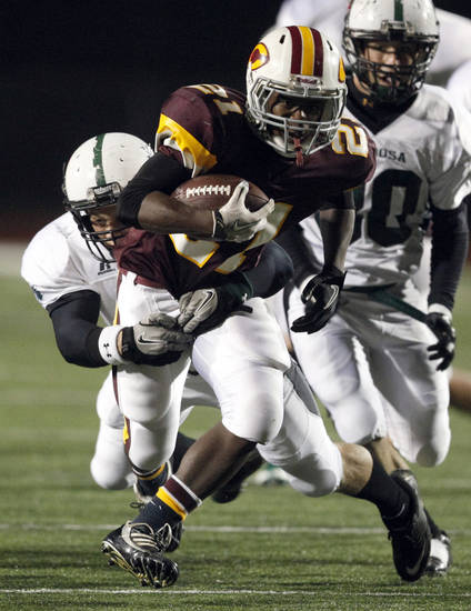Clinton's Jalee Rainge is tackled by Catoosa's Jacob Morgan during the 4A Class high school football playoff game between Clinton and Catoosa at Putnam City High School.,  Friday, Nov. 25, 2011.  Photo by Sarah Phipps, The Oklahoman