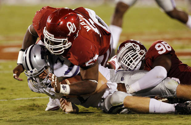 Casey Walker (53) and Chuka Ndulue (98) stop Collin Klein (7) after a short gain during a college football game between the University of Oklahoma Sooners (OU) and the Kansas State University Wildcats (KSU) at Gaylord Family-Oklahoma Memorial Stadium, Saturday, September 22, 2012. Photo by Steve Sisney, The Oklahoman