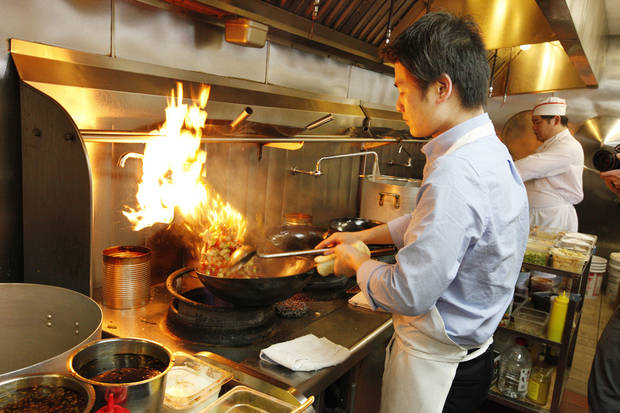 Owner Leo Chen in the kitchen at the Szechuan Bistro. <strong>PAUL B. SOUTHERLAND - THE OKLAHOMAN</strong>