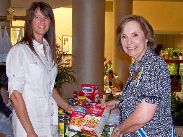 Jennifer Arlan, Regional Food Bank, accepts food donations at DAR State Workshop from State Regent Diane Hamill