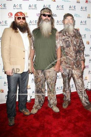 Willie, Phil, and Si Robertson are three of the starts of A&E's Duck Dynasty reality TV series. (AP Photo)
