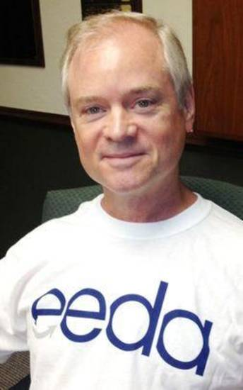 Edmond Economic Development Authority board member Ronnie Williams wear a T-shirt with the authority's new logo. PHOTO BY DIANA BALDWIN, THE OKLAHOMAN