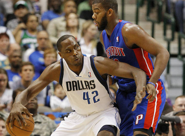 Dallas Mavericks forward Elton Brand (42) battles Detroit Pistons center Greg Monroe (10) for space during the first half of an NBA basketball game, Saturday, Dec. 1, 2012, in Dallas. (AP Photo/Brandon Wade)