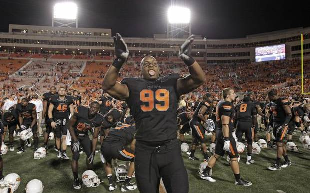 STILLWATER, OK - SEPTEMBER 8:  Defensive end Richetti Jones  #99 of Oklahoma State celebrates after the winning game against the Arizona Wildcats on September 8, 2011 at Boone Pickens Stadium in Stillwater, Oklahoma.  Oklahoma State defeated Arizona 37-14.  (Photo by Brett Deering/Getty Images)