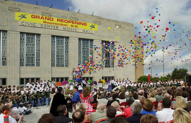 RENOVATE, RENOVATION: Actors in theatrical costume are on stage and among the audience as balloons are released at the conclusion of  the grand reopening ceremonies for the Civic Center Music Hall Thursday morning in downtown Oklahoma City. Staff photo by Jim Beckel.