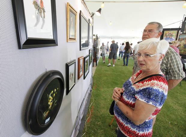 OKC residents Mary and Jim Wells look at paintings during Arts Festival Oklahoma at Oklahoma City Community College in Oklahoma City, OK, Saturday, August 31, 2013,  Photo by Paul Hellstern, The Oklahoman