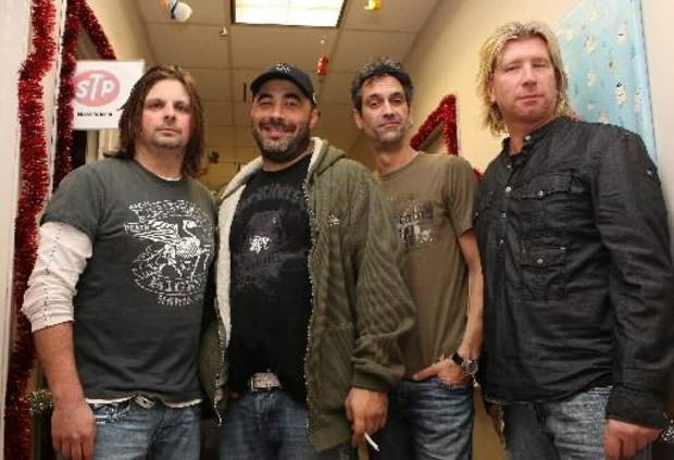 In this Dec. 13, 2012 photo, The Band Staind poses for a photograph at the KROQ Almost Acoustic Christmas held at the Gibson Amphitheater in Universal City California. An ambulance company that serves six rural western Massachusetts towns has purchased a new ambulance thanks to a $150,000 gift from the bass player for the hard rock band Staind. The gift from Johnny April enabled Highland Ambulance to buy a new vehicle to replace its aging 1998 model.(AP Photo/Shea Walsh)