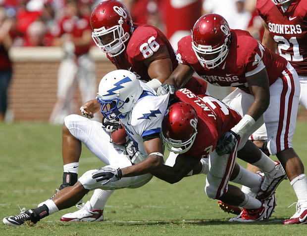 The Oklahoma defense brings down Air Force's Mikel Hunter (30) during the first half of the college football game between the University of Oklahoma Sooners (OU) and the Air Force Falcons at the Gaylord Family - Memorial Stadium on Saturday, Sept. 18, 2010, in Norman, Okla.   Photo by Chris Landsberger, The Oklahoman