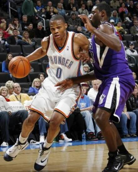 Oklahoma City's  Russell  Westbrook (0) tries to drive past Tyreke Evans (13) of Sacramento during the preseason NBA basketball game between the Sacramento Kings and the Oklahoma City Thunder at the Ford Center in Oklahoma City, Thursday, Oct. 22, 2009. Photo by Nate Billings