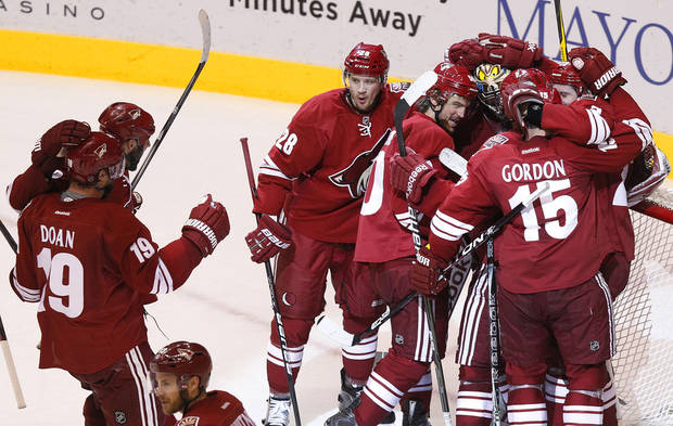 Phoenix Coyotes' Boyd Gordon (15), Lauri Korpikoski (28), of Finland, Shane Doan (19), Oliver Ekman-Larsson, of Sweden, far right, Antoine Vermette (50), and Shane Doan (19) all celebrate with goalie Mike Smith after the third period of Game 5 in an NHL hockey Stanley Cup Western Conference semifinal playoff series against the Nashville Predators Monday, May 7, 2012, in Glendale, Ariz. The Coyotes defeated the Predators 2-1, and advance to the Western Conference finals.(AP Photo/Ross D. Franklin)