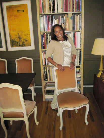 New York designer Elaine Griffin dresses like she decorates. Here she mixes tone and textures, pairing a satin top and cashmere sweater, and slick glossy framed chairs with velvet-upholstered seats.  Photo courtesy of Elaine Griffin