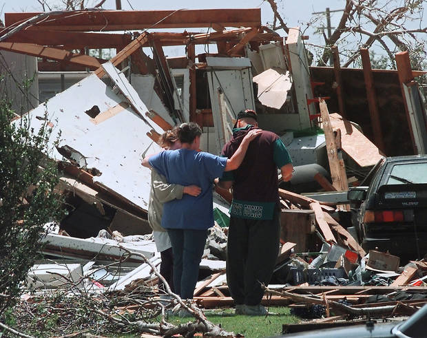 MAY 3, 1999 TORNADO: Tornado victims, damage: Unidentified homeowners comfort each other in storm damaged area in Midwest City.