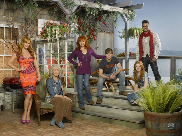 "The new sitcom ""Malibu Country"" stars country music superstar Reba McEntire (center) as Reba, along with, from left, Sara Rue as Kim, Lily Tomlin as Lillie May, Justin Prentice as Cash, Juliette Angelo as June and Jai Rodriguez as Geoffrey. ABC photo. <strong>Edward Herrera</strong>"