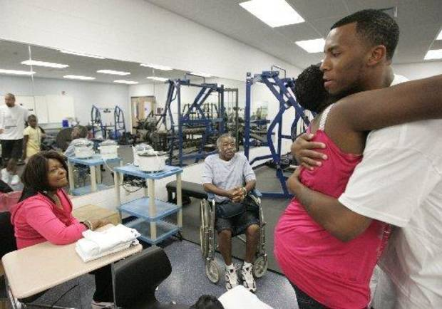 Thunder guard Daequan Cook hugs Janell Sales, mother of DaQuan Sales, who was killed by a motorist on June 13, 2009. PHOTO BY JIM WITMER, DAYTON DAILY NEWS KOD
