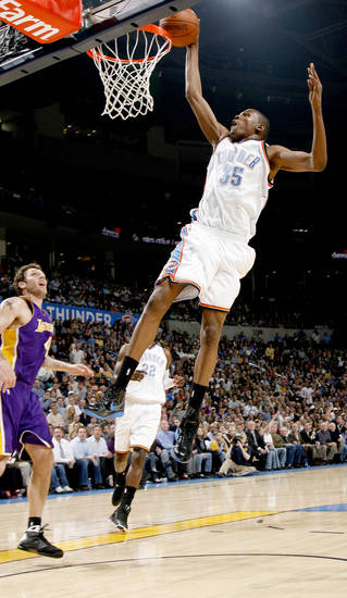 Oklahoma City's Kevin Durant scores of Luke Walton of the Lakers during the NBA basketball game between the Los Angeles Lakers and the Oklahoma City Thunder at the Ford Center,Tuesday, Feb. 24, 2009. PHOTO BY BRYAN TERRY, THE OKLAHOMAN