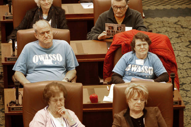 Owasso residents Frank and Sandra Wall listen to lawmakers on the House floor Monday during Senior Day at the state Capitol in Oklahoma City. Photo By Steve Gooch, The Oklahoman &lt;strong&gt;&lt;/strong&gt;