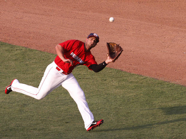 Fernando Martinez (8) catches a ball during a game between the Oklahoma City RedHawks and the Memphis Redbirds in Oklahoma City, Monday, July 2, 2012.  Photo by Garett Fisbeck, The Oklahoman