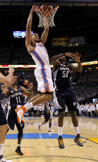 Oklahoma City's Thabo Sefolosha (2) dunks the ball beside Zach Randolph (50) of Memphis during game five of the Western Conference semifinals between the Memphis Grizzlies and the Oklahoma City Thunder in the NBA basketball playoffs at Oklahoma City Arena in Oklahoma City, Wednesday, May 11, 2011. Photo by Bryan Terry, The Oklahoman