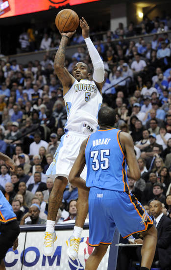 Denver Nuggets guard J.R. Smith (5) shoots a three point shot against Oklahoma City Thunder forward Kevin Durant (35) during the second half in game 4 of a first-round NBA basketball playoff series Monday, April 25, 2011, in Denver. Denver beat Oklahoma 104-101. Oklahoma City leads the series 3-1. (AP Photo/Jack Dempsey)