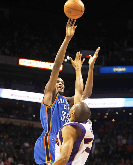 The Thunder's Kevin Durant shoots over the Suns' Grant Hill on Wednesday. AP photo