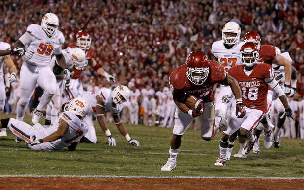 Oklahoma&#039;s Brennan Clay (24) scores the game-winning touchdown during the Bedlam college football game between the University of Oklahoma Sooners (OU) and the Oklahoma State University Cowboys (OSU) at Gaylord Family-Oklahoma Memorial Stadium in Norman, Okla., Saturday, Nov. 24, 2012. Oklahoma won 51-48. Photo by Bryan Terry, The Oklahoman