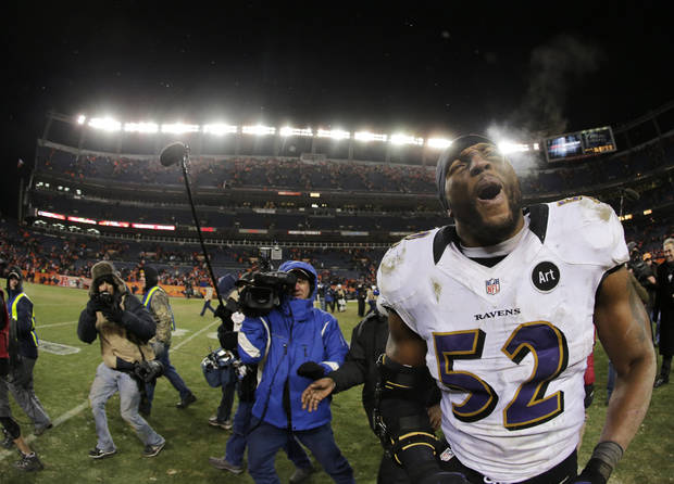 Baltimore Ravens inside linebacker Ray Lewis (52) celebrates after the Ravens beat the Denver Broncos 38-35 in overtime of an AFC divisional playoff NFL football game, Saturday, Jan. 12, 2013, in Denver. (AP Photo/Charlie Riedel)