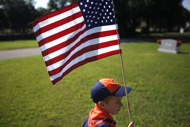 MEMORIAL DAY WEEKEND / VETERANS / GRAVES: Tate Kelly, 7, with Cub Scouts Den 3 carries a flag at Gracelawn Cemetery, Saturday May 29, 2010, in Edmond, Okla. Photo by Sarah Phipps, The Oklahoman       ORG XMIT: KOD