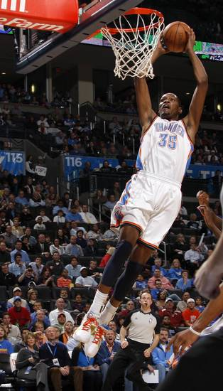Oklahoma City's Kevin Durant (35) dunks the ball during the NBA basketball game between the Oklahoma City Thunder and the Golden State Warriors at the Oklahoma City Arena, Tuesday, March 29, 2011. Photo by Bryan Terry, The Oklahoman